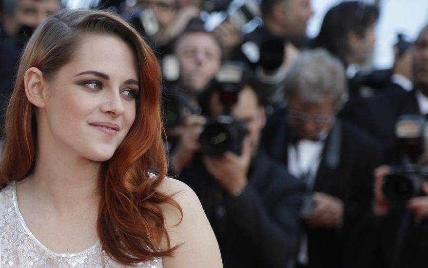 Actress Kristen Stewart arrives for the screening of Sils Maria at the 67th international film festival, Cannes, southern France, Friday, May 23, 2014. (AP Photo/Thibault Camus)