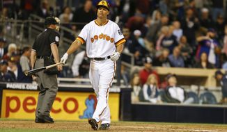 San Diego Padres' Will Venable walks away from home plate after striking out to end the Padres' 5-1 loss to the Chicago Cubs in a baseball game Thursday, May 22, 2014, in San Diego. Padres hitters struck out ten times in the game.  (AP Photo/Lenny Ignelzi)