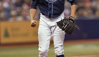 Tampa Bay Rays starter Chris Archer reacts to striking out Boston Red Sox batter A.J. Pierzynski during the sixth inning of a baseball game Friday, May 23, 2014 in St. Petersburg, Fla. (AP Photo/Steve Nesius)