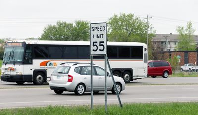 "ADVANCE FOR MONDAY MAY 26 AND THEREAFTER - In this May 21, 2014 photo, a speed limit sign posts a 55 miles per hour speed limit for traffic on State Highway 13 in Burnsville, Minn. Lawmakers have urged transportation officials to boost the speed limit to 60 mph where it can ""reasonably and safely"" be done on two lane-two way state highways now covered by a 55 mph limit. (AP Photo/Jim Mone)"