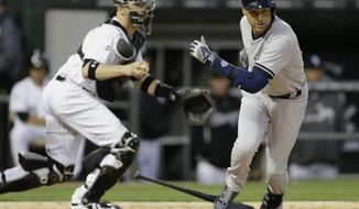 New York Yankees' Derek Jeter, right, runs to first base on a drop third strike as Chicago White Sox catcher Tyler Flowers looks to a throw during the fourth inning of a baseball game in Chicago on Thursday, May 22, 2014. (AP Photo/Nam Y. Huh)