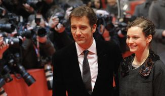 "In this Feb. 5, 2009 file photo, British actor Clive Owen, left, and his wife Sarah-Jane Fenton arrive for the screening of the Berlinale opening movie ""The International'"" at the Berlinale in Berlin. Over the years Owen has starred with beautiful leading ladies such as Angelina Jolie and Julia Roberts, but only one former actress holds the key to his heart, Fenton. The couple have been married for almost 20 years. (AP Photo/Eckehard, file)"