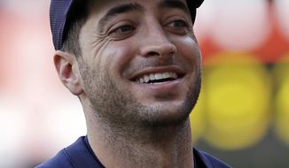 Milwaukee Brewers right fielder Ryan Braun smiles at fans before a baseball game against the Miami Marlins in Miami, Friday, May 23, 2014. Braun was out of the Brewers starting lineup Friday after a flare-up of the oblique strain that sent him to the disabled list earlier this season. (AP Photo/Alan Diaz)