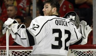 Los Angeles Kings goalie Jonathan Quick looks to the bench during the second period in Game 2 of the Western Conference finals in the NHL hockey Stanley Cup playoffs against the Chicago Blackhawks in Chicago on Wednesday, May 21, 2014. (AP Photo/Nam Y. Huh)