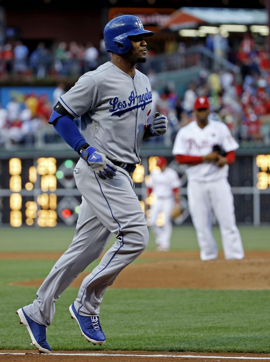Philadelphia Phillies starting pitcher Roberto Hernandez watches as Los Angeles Dodgers' Carl Crawford rounds the bases after Crawford hit a home run during the second inning of a baseball game, Friday, May 23, 2014, in Philadelphia. (AP Photo/Matt Slocum)