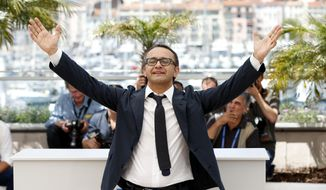 Director Andrey Zvyagintsev poses for photographers during a photo call for Leviathan at the 67th international film festival, Cannes, southern France, Friday, May 23, 2014. (AP Photo/Alastair Grant)
