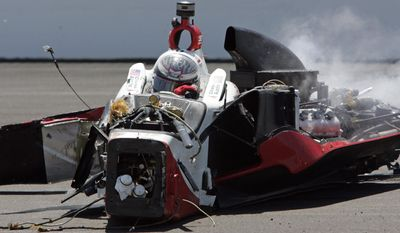 The car driven by Chase Austin comes to a rest after hitting wall in the first turn during the Indy Lights Freedom 100 auto race at the Indianapolis Motor Speedway in Indianapolis, Friday, May 23, 2014. (AP Photo/Joe Watts)