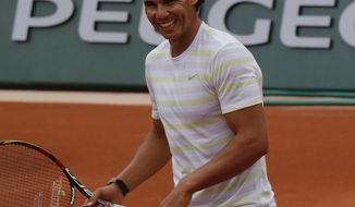 Defending champion Spain's Rafael Nadal smiles during a training session for the French Open tennis tournament, at the Roland Garros stadium in Paris, Friday, May 23, 2014. The French Open tennis championship will start Sunday. (AP Photo/Bertrand Combaldieu)