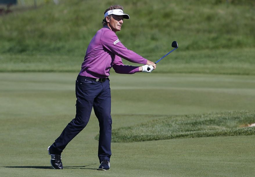 Bernhard Langer hits a fairway shot on the ninth hole during the second round of the 75th Senior PGA Championship golf tournament at Harbor Shores Golf Club in Benton Harbor, Mich., Friday, May 23, 2014. (AP Photo/Paul Sancya)