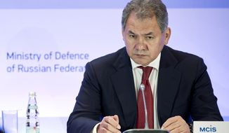 Russian Defense Minister Sergei Shoigu listens during a security conference in Moscow, Russia on Friday, May 23, 2014. Russia on Friday urged the West to stop playing what he described as a zero-sum game against Russia and reach a settlement based on mutual interests.  (AP Photo/Pavel Golovkin)