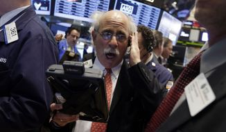 Trader Peter Tuchman works on the floor of the New York Stock Exchange, Friday, May 23, 2014. Stocks inched higher early Friday in quiet trading ahead of the Memorial Day weekend.  (AP Photo/Richard Drew)
