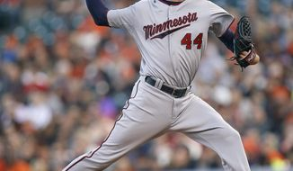 Minnesota Twins starting pitcher Kyle Gibson throws against the San Francisco Giants in the first inning of a baseball game Friday, May 23, 2014, in San Francisco. (AP Photo/Tony Avelar)