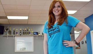 ADVANCE FOR SUNDAY MAY 25 AND THEREAFTER This Thursday May 15, 2014 photo shows Bridget Rowsey, owner of Bridget's Dance Academy, at her studio in Huntington, W.Va. Rowsey was named 2014 West Virginia Young Entrepreneur of the Year by the U.S. Small Business Administration.  (AP Photo/The Herald-Dispatch, Shane Arrington)