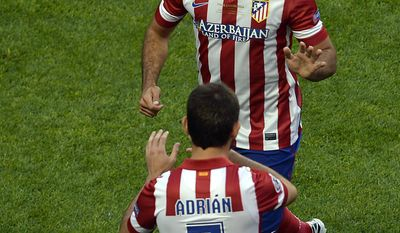 Atletico's Diego Costa, rear, leaves the pitch and is replaced by Atletico's Adrian Lopez during the Champions League final soccer match between Atletico Madrid and Real Madrid in Lisbon, Portugal, Saturday, May 24, 2014. (AP Photo/Paulo Duarte)