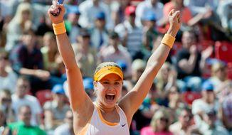 Canadian Eugenie Bouchard celebrates after defeating Czech  Karolina Pliskova at the WTA final in Nuremberg, Germany, Saturday, May 24, 2014. Bouchard won 6-2, 4-6, 6-3. (AP Photo/dpa, Daniel Karmann)
