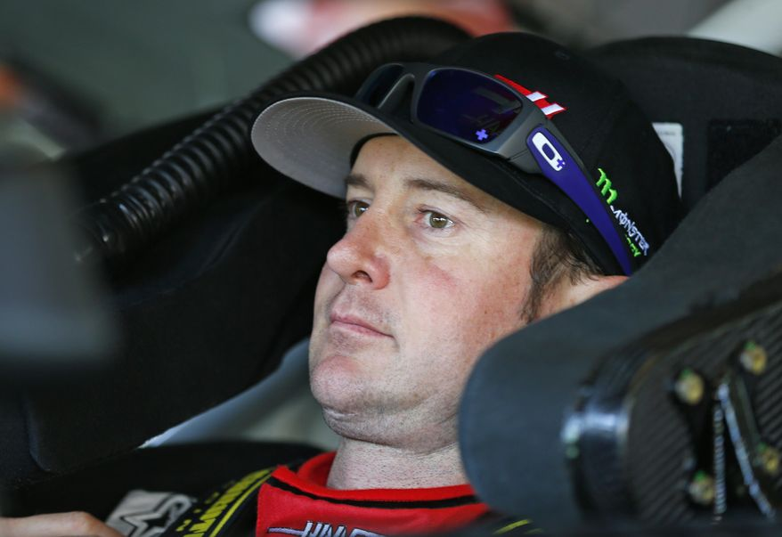 Kurt Busch waits in his car before practice for Sunday's NASCAR Sprint Cup series Coca-Cola 600 auto race at Charlotte Motor Speedway in Concord, N.C., Saturday, May 24, 2014. (AP Photo/Chris Keane)