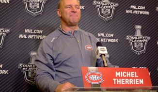 Montreal Canadiens coach Michel Therrien speaks during a news conference after NHL hockey practice Saturday May 24, 2014 at Madison Square Garden in New York. (AP Photo/The Canadian Press, Neil Davidson)
