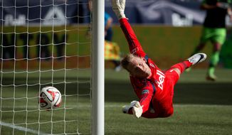 Vancouver Whitecaps' goalkeeper David Ousted, of Denmark, allows a goal to Seattle Sounders' Chad Barrett during the first half of an MLS soccer game in Vancouver, British Columbia, Saturday, May 24, 2014. (AP Photo/The Canadian Press, Darryl Dyck)