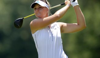Anna Nordqvist, of Norway, tees off on the seventh hole in the third round of the Airbus LPGA Classic golf tournament at Magnolia Grove on Saturday, May 24, 2014, in Mobile, Ala. (AP Photo/G.M. Andrews)