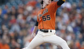 San Francisco Giants starting pitcher Tim Lincecum throws against the Minnesota Twins in the first inning of a baseball game Friday, May 23, 2014, in San Francisco. (AP Photo/Tony Avelar)