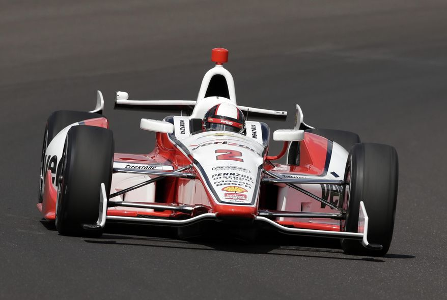 In this photo taken on May 17, 2014, Juan Pablo Montoya, of Colombia, drives through the first turn on the first day of qualifications for Indianapolis 500 IndyCar auto race at the Indianapolis Motor Speedway in Indianapolis. Montoya needed four races to get comfortable again in an Indy car. His feel has returned just in time for the Indianapolis 500, the race he won in 2000. (AP Photo/AJ Mast)