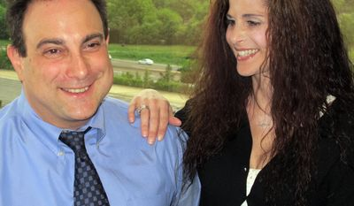 In this May 21, 2014 photo, Martin Tankleff, who spent 17 years in prison for killing his parents and was freed in 2007 when an appeals court found key evidence in his trial was overlooked, poses for a photo with his wife, Laurie Tankleff, at a Long Island law firm where he works in in Garden City, N.Y. Tankleff graduated from Touro Law School on Sunday, May 25, 2014, and said he intends to work to exonerate wrongly convicted prisoners. (AP Photo/Frank Eltman)
