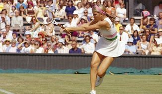 FILE - This is a 1975 file photo showing Chris Evert playing tennis. Evert won the first of her 18 career Grand Slam titles at the 1974 French Open. When this year's edition of the clay-court Grand Slam tournament begins Sunday May 25, 2014, Evert will be on hand at Roland Garros as a TV analyst for ESPN, watching what's become a changed brand of tennis four decades later. (AP Photo/File)