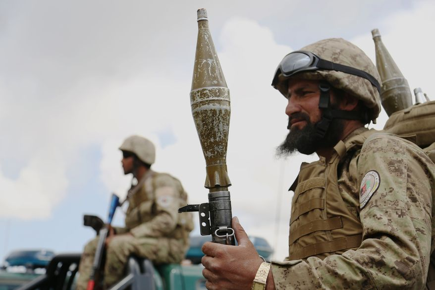 An Afghan security men stands guard during a campaign rally in Paktiya province, east of Kabul, Afghanistan, Saturday, May 24, 2014. The campaign season for the second round of Afghanistan's presidential election kicked off on Thursday. (AP Photo/Rahmat Gul)