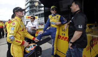 In this photo taken on May 11, 2014, car owner Michael Andretti, right, talks with drivers Ryan Hunter-Reay, left, and Marco Andretti during practice for Indianapolis 500 IndyCar auto race at the Indianapolis Motor Speedway in Indianapolis. (AP Photo/Darron Cummings)