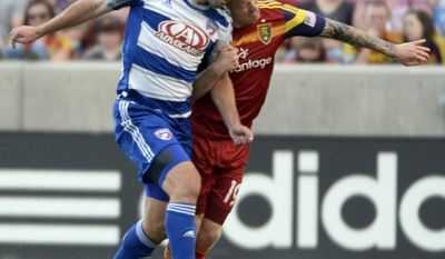Real Salt Lake midfielder Luke Mulholland (19) collides with FC Dallas midfielder Adam Moffat during an MLS soccer game on Saturday, May 24, 2014, in Sandy, Utah. (AP Photo/The Salt Lake Tribune, Rick Egan) LOCAL TV OUT; MAGAZINES OUT; DESERET NEWS OUT