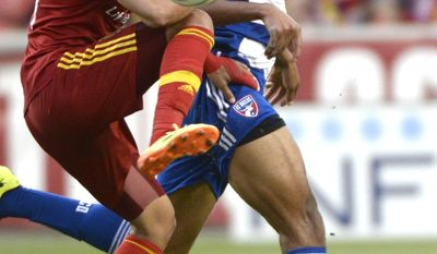 Real Salt Lake midfielder Javier Morales, left, stops the ball against FC Dallas during an MLS soccer game on Saturday, May 24, 2014, in Sandy, Utah. (AP Photo/The Salt Lake Tribune, Rick Egan) LOCAL TV OUT; MAGAZINES OUT; DESERET NEWS OUT