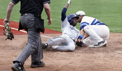 Xavier's Andre Jernigan, center, slides safely home against Seton Hall infielder Sal Annunziata, right, in the sixth inning of an NCAA college baseball game in the Big East Conference tournament on Saturday, May 24, 2014, in New York. (AP Photo/John Minchillo)