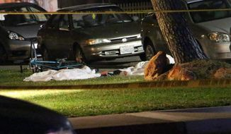 "In this image provided by KEYT-TV, bodies are seen covered on the ground after a mass shooting near the campus of the University of Santa Barbara in Isla Vista, Calif., Friday, May 23, 2014.  A drive-by shooter went on a ""mass murder"" rampage near the Santa Barbara university campus that left seven people dead, including the attacker, and seven others wounded, authorities said Saturday. (AP Photo/KEYT, John Palminteri)"