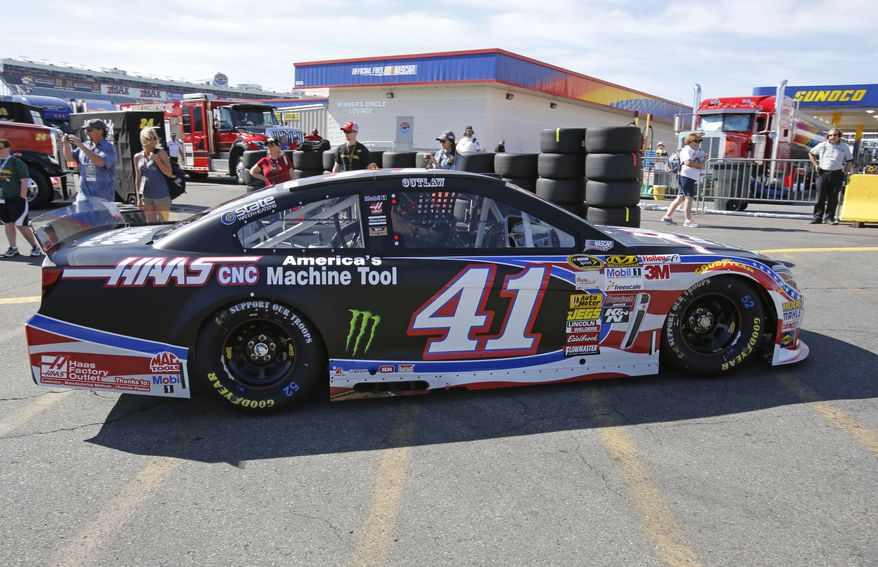 Kurt Busch drives his car from the garage during practice for Sunday's NASCAR Sprint Cup series Coca-Cola 600 auto race at Charlotte Motor Speedway in Concord, N.C., Saturday, May 24, 2014. (AP Photo/Terry Renna)