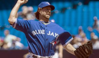 Toronto Blue Jays starting pitcher R.A. Dickey works against the Oakland Athletics during the first inning of a baseball game in Toronto on Saturday, May 24, 2014. (AP Photo/The Canadian Press, Darren Calabrese)
