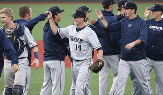 Xavier pitcher Sean Campbell, center, celebrates with his teammates after their 5-3 win over Seton Hall in an NCAA college baseball game in the Big East Conference tournament, Saturday, May 24, 2014, in New York. (AP Photo/John Minchillo)