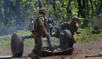 French Sangaris forces fire warning flares with a 120mm mortar against ex-Seleka elements  in  Bamberi, Central African Republic, Saturday May 24, 2014. Following at exchange of fire, a French combat helicopter fired a rocket and destroyed an ex-Seleka pickup. (AP Photo/Jerome Delay) ONLINE OUT FRANCE OUT