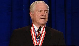 Former Defense Secretary Robert Gates addresses the Boy Scouts of America's annual meeting on Friday, May 23, 2014, in Nashville, Tenn., after being selected as the organization's new president. Gates is taking over one of the nation's largest youth organizations as it fights a membership decline and debates its policy toward gays. (AP Photo/Mark Zaleski)