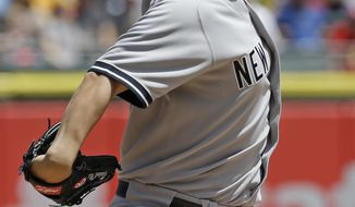 New York Yankees starter Vidal Nuno throws against the Chicago White Sox during the first inning of a baseball game in Chicago on Saturday, May 24, 2014. (AP Photo/Nam Y. Huh)
