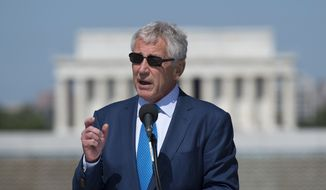 With the Lincoln Memorial in the background, Defense Secretary Chuck Hagel speaks at a 10th anniversary ceremony for the WWII Memorial in Washington, Saturday, May 24, 2014, ahead of Memorial Day on Monday. (AP Photo/Molly Riley)
