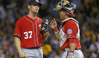 Washington Nationals starting pitcher Stephen Strasburg (37) gets a visit from catcher Wilson Ramos during the seventh inning of a baseball game against the Pittsburgh Pirates in Pittsburgh, Saturday, May 24, 2014. (AP Photo/Gene J. Puskar)