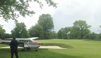 In this Saturday, May 24, 2014 photograph provided by Stephen P Wolsky, a small airplane rests on a fairway after making an emergency landing at Mountain Ridge Country Club in West Caldwell, N.J. Authorities say no injuries were reported. (AP Photo/Stephen P. Wolsky)