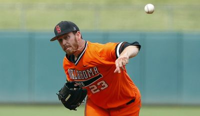 Oklahoma State starting pitcher Michael Freeman delivers against TCU in the first inning of the championship game during the Big 12 conference NCAA college baseball tournament in Oklahoma City, Sunday, May 25, 2014. (AP Photo/Alonzo Adams)
