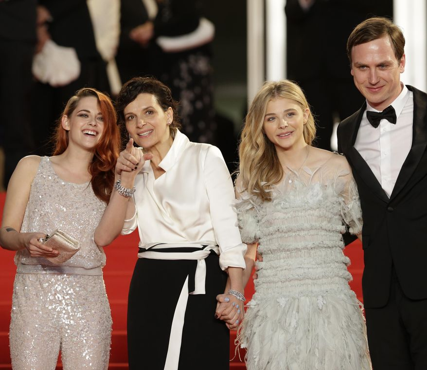 From left, actress Kristen Stewart, actress Juliette Binoche, actress Chloe Grace Moretz and actor Lars Eidinger pose for photographers following the screening of Sils Maria at the 67th international film festival, Cannes, southern France, Friday, May 23, 2014. (AP Photo/Thibault Camus)