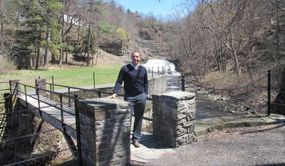 This April 24, 2014, shows Ithaca, N.Y. Mayor Svante Myrick at one of the city's gorges in Ithaca, N.Y.  Myrick says he draws heavily on life experience as he shapes public policy, which may seem odd for someone still only in his 20s.  The city's youngest-ever mayor says his approach to Ithaca's budget gap and even homeless population can be traced to a childhood that took him from a homeless shelter to the Ivy League.  (AP Photo/Carolyn Thompson)