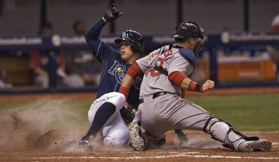 Tampa Bay Rays' Brandon Guyer, left, beats the tag from Boston Red Sox catcher A.J. Piezynski, right, to score during the seventh inning of a baseball game Sunday, May 25, 2014 in St. Petersburg, Fla. (AP Photo/Steve Nesius)