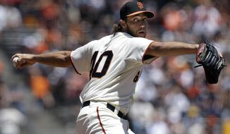 San Francisco Giants pitcher Madison Bumgarner throws against the Minnesota Twins during the first inning of a baseball game in San Francisco, Sunday, May 25, 2014. (AP Photo/Jeff Chiu)