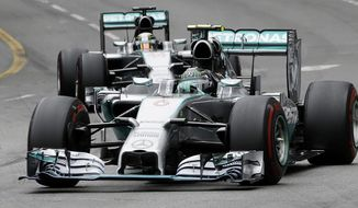 Mercedes driver Nico Rosberg of Germany leads his teammate Mercedes driver Lewis Hamilton of Britain during the Monaco Formula One Grand Prix, at the Monaco racetrack, in Monaco, Sunday, May 25, 2014. (AP Photo/Luca Bruno)