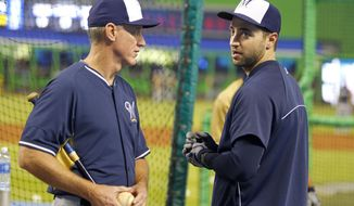 Milwaukee Brewers right fielder Ryan Braun, right, speaks with manager Ron Roenicke during batting practice before a baseball game Miami Marlins in Miami, Saturday, May 24, 2014. Braun has been out of the lineup because of a flare-up of an oblique strain that put him on the disable list earlier in the season. (AP Photo/Joe Skipper)