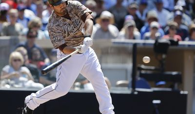 San Diego Padres pinch hitter Carlos Quentin slams a base hit to left to bring in the go ahead run against the Chicago Cubs during the sixth inning of a baseball game Sunday, May 25, 2014, in San Diego. Quentin hit a two-run home run pinch hitting in the last game. (AP Photo/Lenny Ignelzi)
